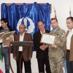 stretta mano sindaco Assad e colonnello Galletti